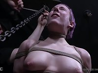 Bound girl moans as a vibrator pleasures her clit
