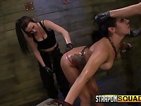 Two latex mistresses wearing strapons fuck poor tied up babe Isa Mendez