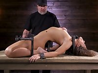 Restrained porn model Victoria Voxxx is punished with vibrator and long stick