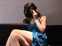 Heavy breathing gas mask girl striptease