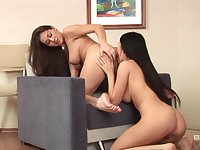Naked lezzie hotties share passion and lust on a chair