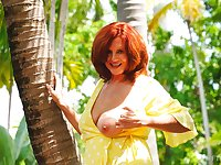 Redhead amateur mature Andi drops her panties to tease in outdoors