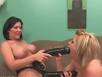 Lesbian babes use massive strapon to pleasure their cravings