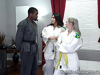 Fine women share a huge black dick in Karate XXX threesome