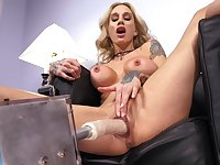 Tattooed model Sarah Jessie spreads her legs to be fucked by a sex machine