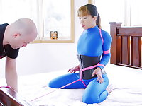 Bed bound in blue catsuit