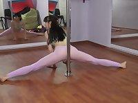 Petite slut shows her practice moves as a pole dancer