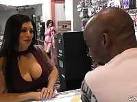 Captivating hooker with big boobs Melissa Lynn goes black in the glory hole room